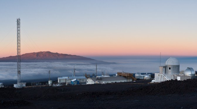 Panoramic view of the Mauna Loa Observatory or MLO.  MLO is located on the north flank of the Mauna Loa Volcano at an altitude of 11,135 feet above sea level and has been continuously monitering and collecting data related to climate change, atmospheric c